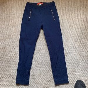 Anthropologie navy high-waisted pants.